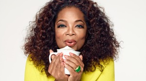 A picture of Oprah blowing on a latte.